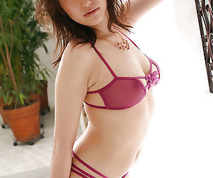 Sexy asian babe in lingerie Takako Kitahara uncovering her..
