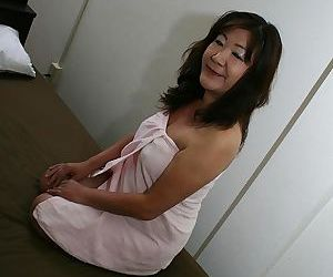 Saucy asian granny Michiko Okawa toying her hairy twat..