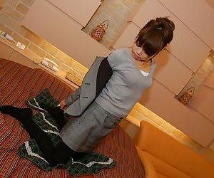 Asian MILF Miyuki Takizawa stripping and exposing her..