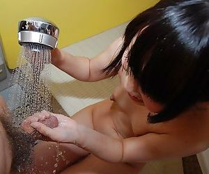 Asian teen Chisa Nagata gives a sensual hand and blowjob..