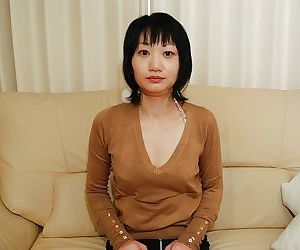 Shy asian MILF strips down and gets her shaved twat..