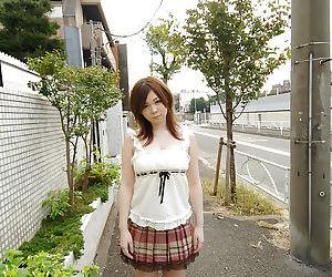 Asian schoolgirl Nami Ogawa revealing her massive bosoms..
