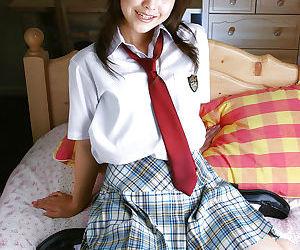Naughty asian schoolgirl Ayumi Motomura slipping off her..