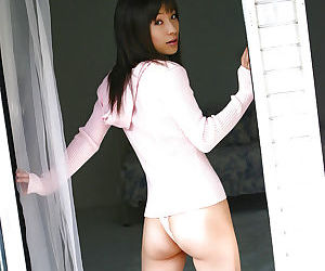 Graceful asian babe in sport outfit uncovering her..