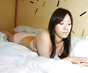 Shy asian chick strips down and showcases her hairy twat..