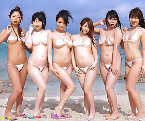 Asian in small bikini gangbanged on the beach - part 465