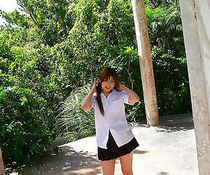 Japanese schoolgirl removes uniform - part 2834
