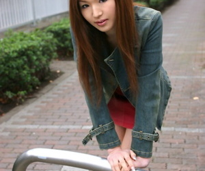 Beautiful Japanese teen Kaoru stands totally naked after..