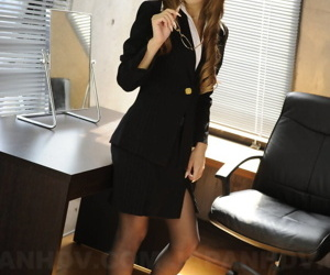 Japanese businesswoman Ramu Nagatsuki opens her blouse in..