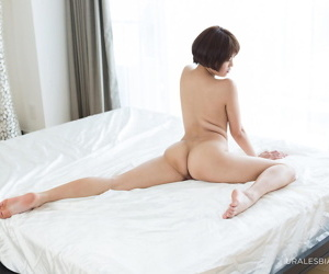 Naked Japanese lesbians spread their flexible legs for..