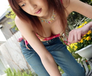 Petite asian teen babe Mio Komori stripping off her clothes