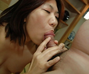 Asian MILF Yoko Ikeda gets her hairy pussy pleased with..