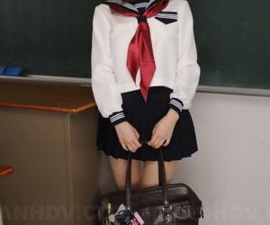 Cute Japanese redhead Nazuna Otoi frees her trimmed muff..