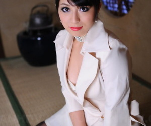 Classy Japanese model Nana Kunimi flashes her lace bra..