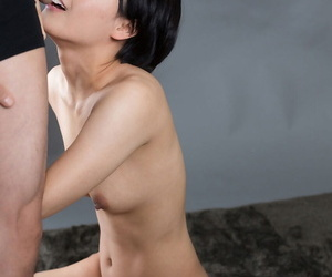 Cute little Asian girl gets on her knees naked to suck..