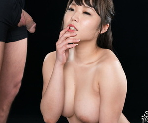 Naked Japanese girl coxes cum from a cock with a blowjob..