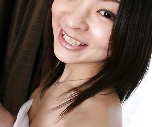 Slim asian MILF Aika Tono poses naked and showcases her..