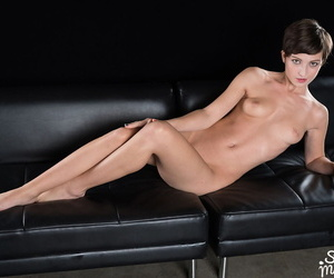 Short haired girl sucks off a couple of cocks at once..