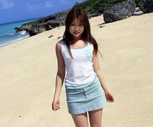 Adorable Japanese girl Miyu Sugiura frees sand clad ass..
