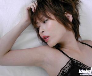 Seductive asian babe Nana Natsume stripping off her..