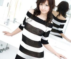 Alluring asian coed on high heels Misaki Mori stripping..