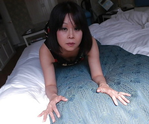 Naughty asian MILF Yukari Yamagishi getting naked and..