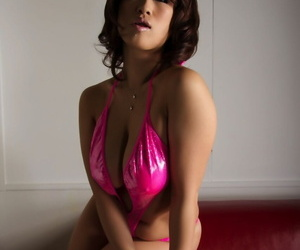 Japanese woman model lets a breast slip free while..