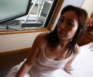 Lewd asian granny Masae Funakoshi stripping and playing..