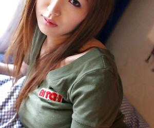 Stunning asian teenage babe Mai Hanano stripping off her..