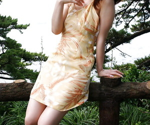 Nasty asian cutie An Nanba slipping off her dress outdoor