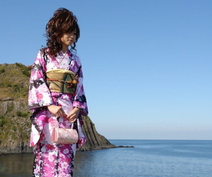 Asian model Chiaki strolls along the beach and surrounding..
