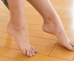Young naked Asian with bare feet giving a footjob to some..