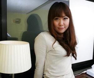 Asian MILF Hiroko Nagatomo undressing and spreading her..