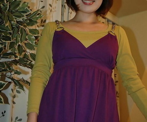 Asian teenage sweetie Kazumi Shindou undressing and..