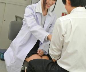 Brunette Asian doctor Tomomi Motozawa rubs her twat in her..