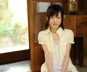 Tiny Japanese girl Aoba Itou models non nude in satin..