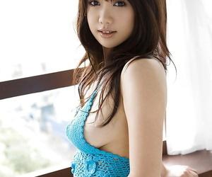 Busty asian babe on high heels Mai Nadasaka stripping off..