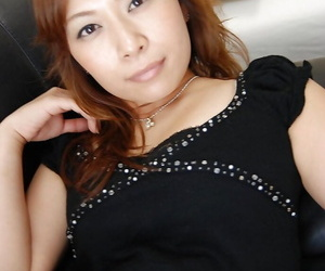 Asian MILF Machiko Nishizaki undressing and exposing her..