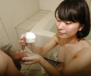 Lovely asian teen gives a wet hand and blowjob in the..