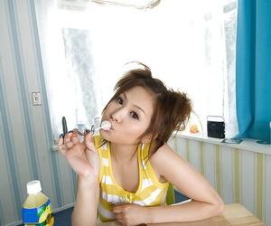 Busty asian teen babe on high heels Yui Aoyama stripping..