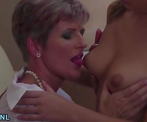 Two mature lesbians sharing a..