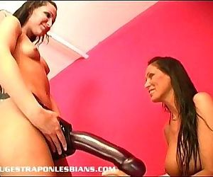 Giant strapon dildo makes her..