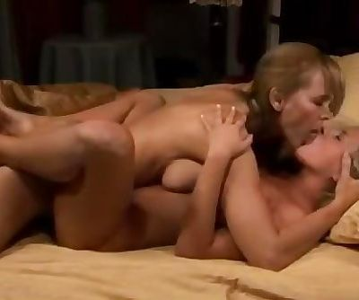 Young and mature lesbians have strapon sex