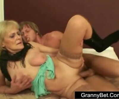 Hooker granny is picked up and fucked in hotel