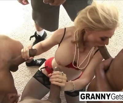 The legendary Nina Hartley gets an amazing interracial gangbang