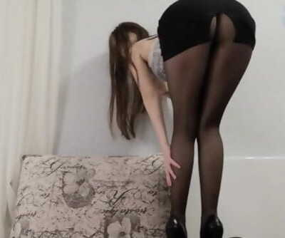 young sexy bitch in heels and show skirt
