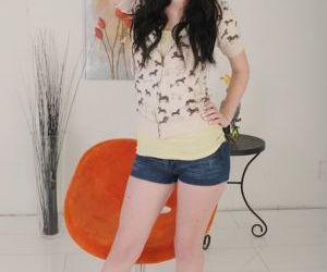 Foxy brunette in jeans shorts..