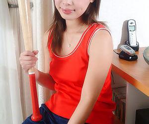 Brunette Asian teen Yumi teases..