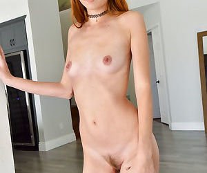 Ginger babe with small breasts..