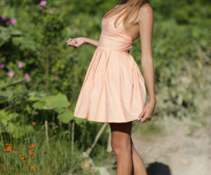 Clothed teen babe exposing shaved..